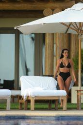 Kim Kardashian in Black Bikini - Enjoys the Pool in Mexico - June 2014