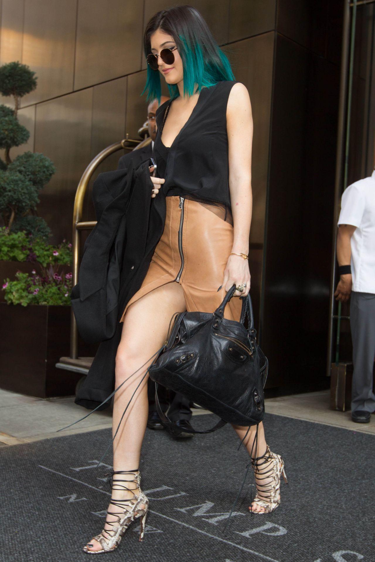 Kylie Jenner Shows Off Her Legs In Mini Skirt Leaving The