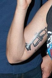 Lady Gaga Gets Trumpet Tattoo on Her Upper Arm -  Tattoo Parlor in New York - June 2014