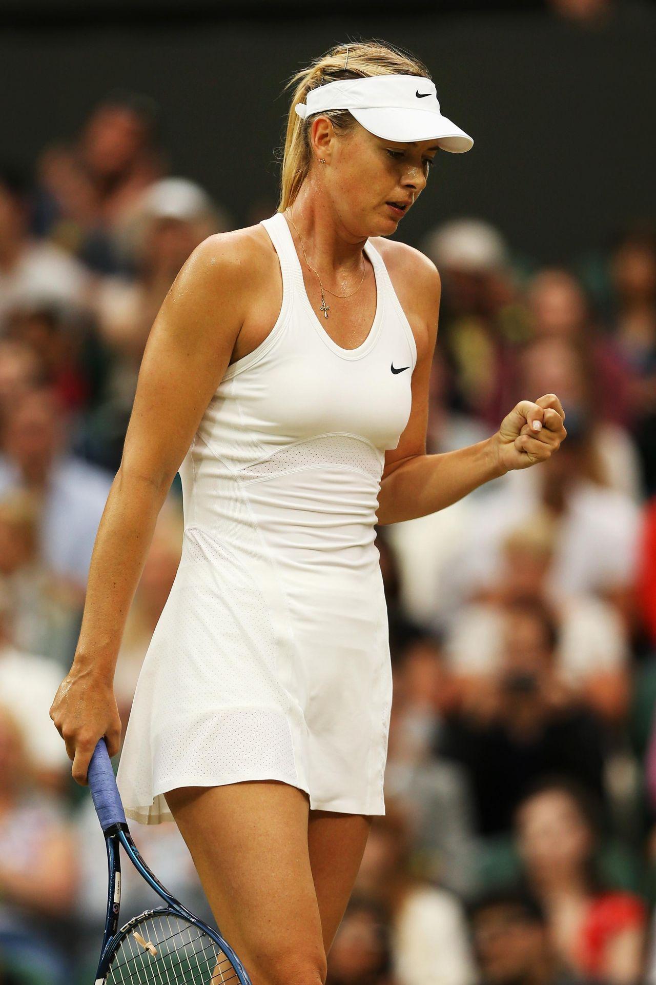 Maria Sharapova shows her 2011 Wimbledon tennis dress.JPG