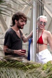 Miley Cyrus in Red Bikini at a hotel Pool in Barcelona - June 2014