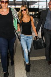 Nicola Peltz in Jeans at LAX Airport in Los Angeles - June 2014