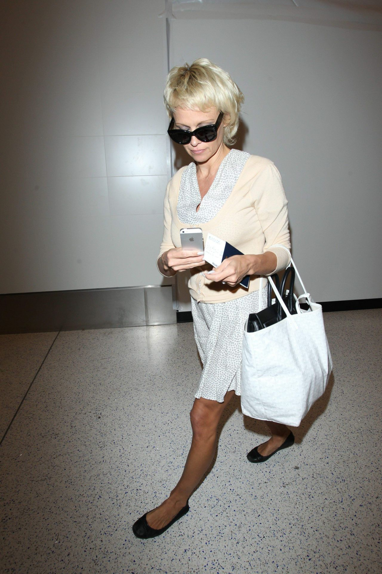 Pamela Anderson Arrives at the LAX Airport - June 2014
