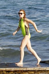 Lindsay Lohan in a Swimsuit at a Beach in Ibiza - July 2014