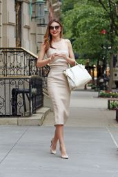 Miranda Kerr in a Fitted Beige Dress - Exiting Her Apartment in NYC - July 2014