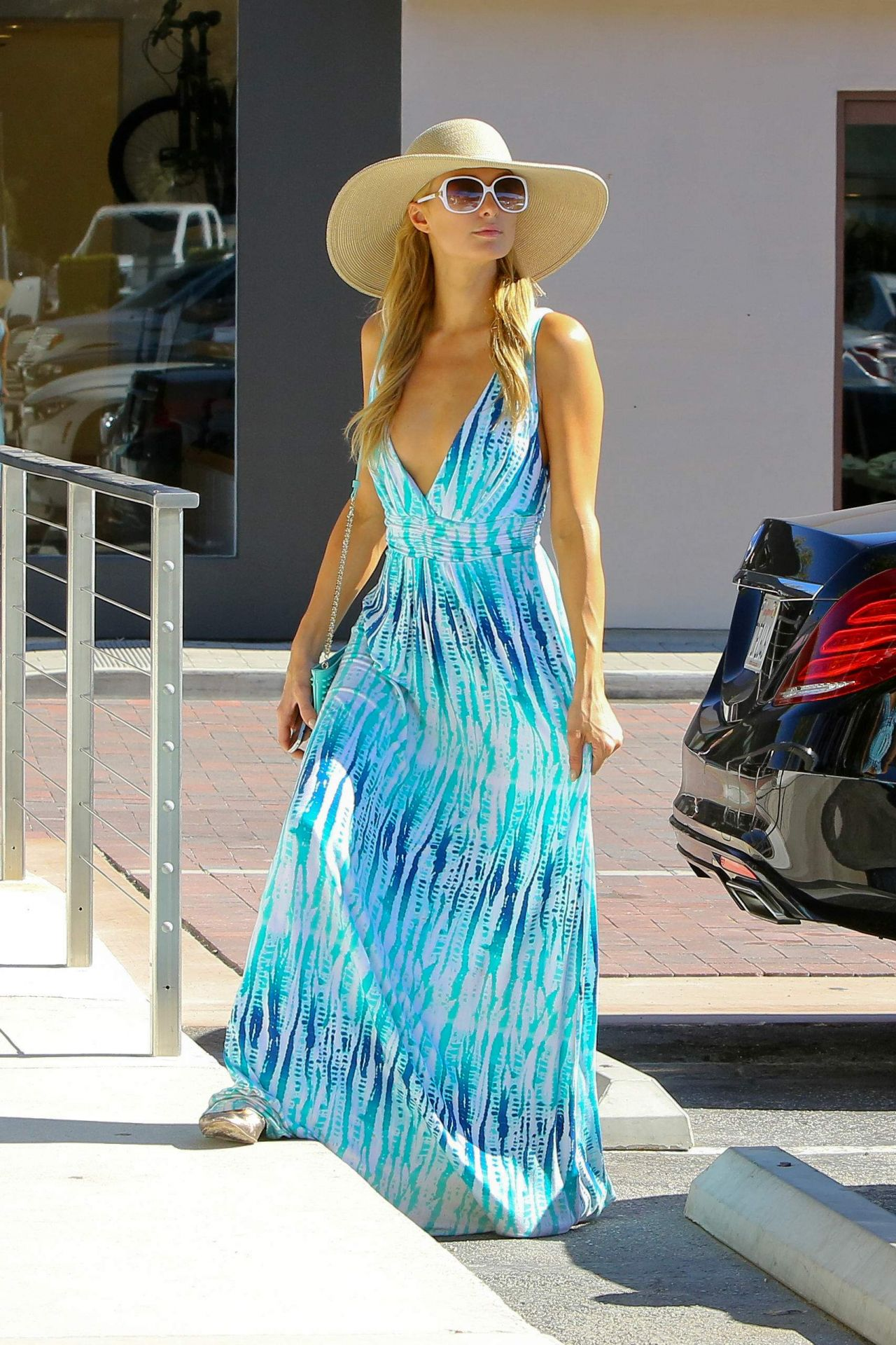 paris hilton in a blue and white dress for a visit to the