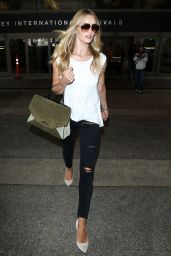 Rosie Huntington-Whiteley Arriving at LAX airport in Los Angeles - July 2014