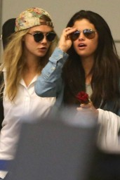 Selena Gomez & Cara Delevingne at LAX Airport in LA – July 2014