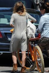 AnnaLynne McCord - Cycling Home From Lunch in Venice - August 2014