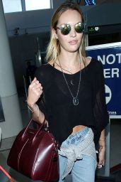 Candice Swanepoel in Ripped Jeans at LAX Airport - August 2014