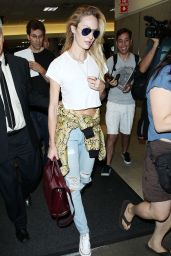 Candice Swanepoel in Ripped Jeans at LAX Airport - September 2014