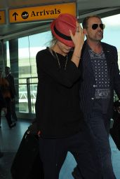 Cara Delevingne at Heathrow Airport in London - September 2014