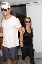 Elsa Pataky & Chris Hemsworth - Aarrives at LAX Airport in Los Angeles - August 2014