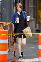 Emma Stone With Umbrella - Out in New York City - Septemeber 2014