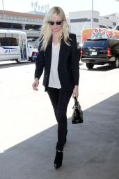 Kirsten Dunst Arriving at LAX Airport to Catch a Flight in Los Angeles - September 2014