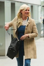 Kirsten Dunst - Catching a flight at London Heathrow Airport - August 2014