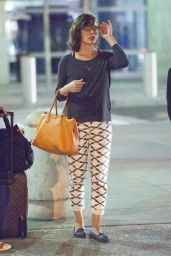 Milla Jovovich - Arrives at JFK Airport in New york City - September 2014