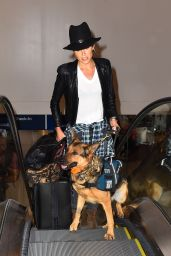Nikki Reed With Her Dogat at LAX Airport in Los Angeles - September 2014