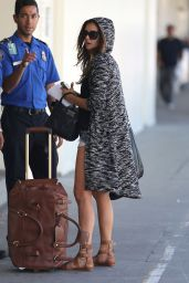 Nina Dobrev in Jeans Shorts at LAX Airport - September 2014