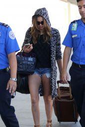 Nina Dobrev in Jeans Shorts at LAX Airport - September 2014