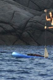 Rihanna in a Bikini - Paddleboarding in Italy, August 2014