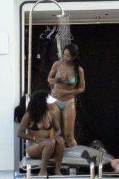 Rihanna in a Bikini - Paddleboarding in Italy, August 2014