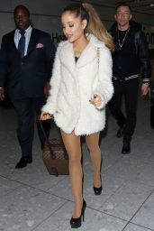Ariana Grande Shows Legs at Heathrow Airport in London - October 2014