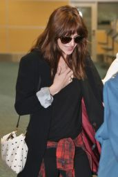 Dakota Johnson Arriving at the Airport in Vancouver - October 2014