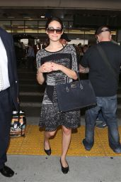 Emmy Rossum at LAX Airport - Arriving From a Flight in Los Angeles - Oct. 2014