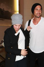 Kaley Cuoco & Ryan Sweeting - Both Wearing Beanies at LAX Airport - October 2014