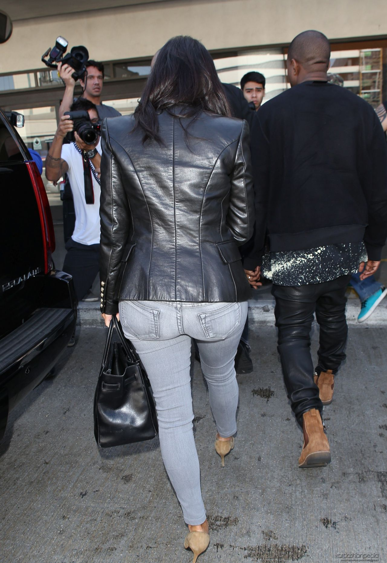 kim kardashian in jeans at lax airport october 2014