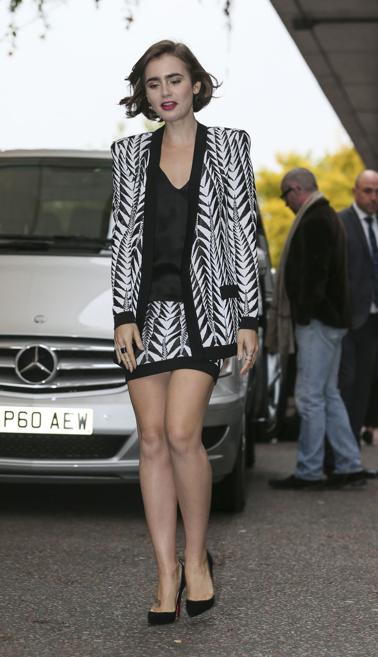 Lily Collins Leggy Out In London October 2014