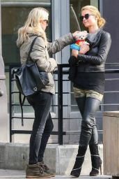 Paris Hilton With Her Dog Waiting for a Cab in the East Village in New York City - Oct. 2014