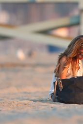Sarah Hyland Writing in a Journal at the Beach in Los Angeles