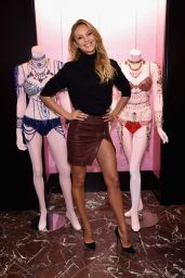 Candice Swanepoel in Leather Mini Skirt - Shares Victoria