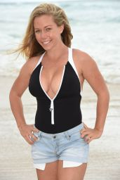 Kendra Wilkinsonin a Black swimsuit at a Beach in Queensland, Australia