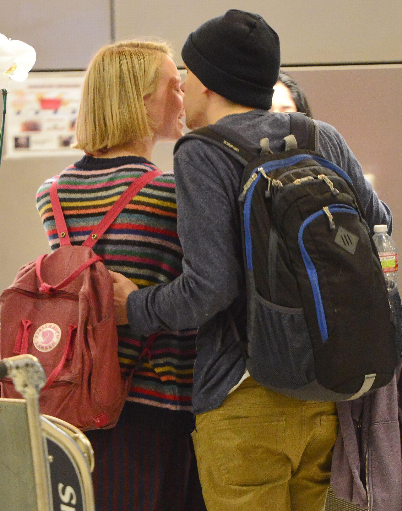 3fd431d55d Mia Wasikowska   Jesse Eisenberg – Share a Kiss at LAX Airport – Nov. 2014