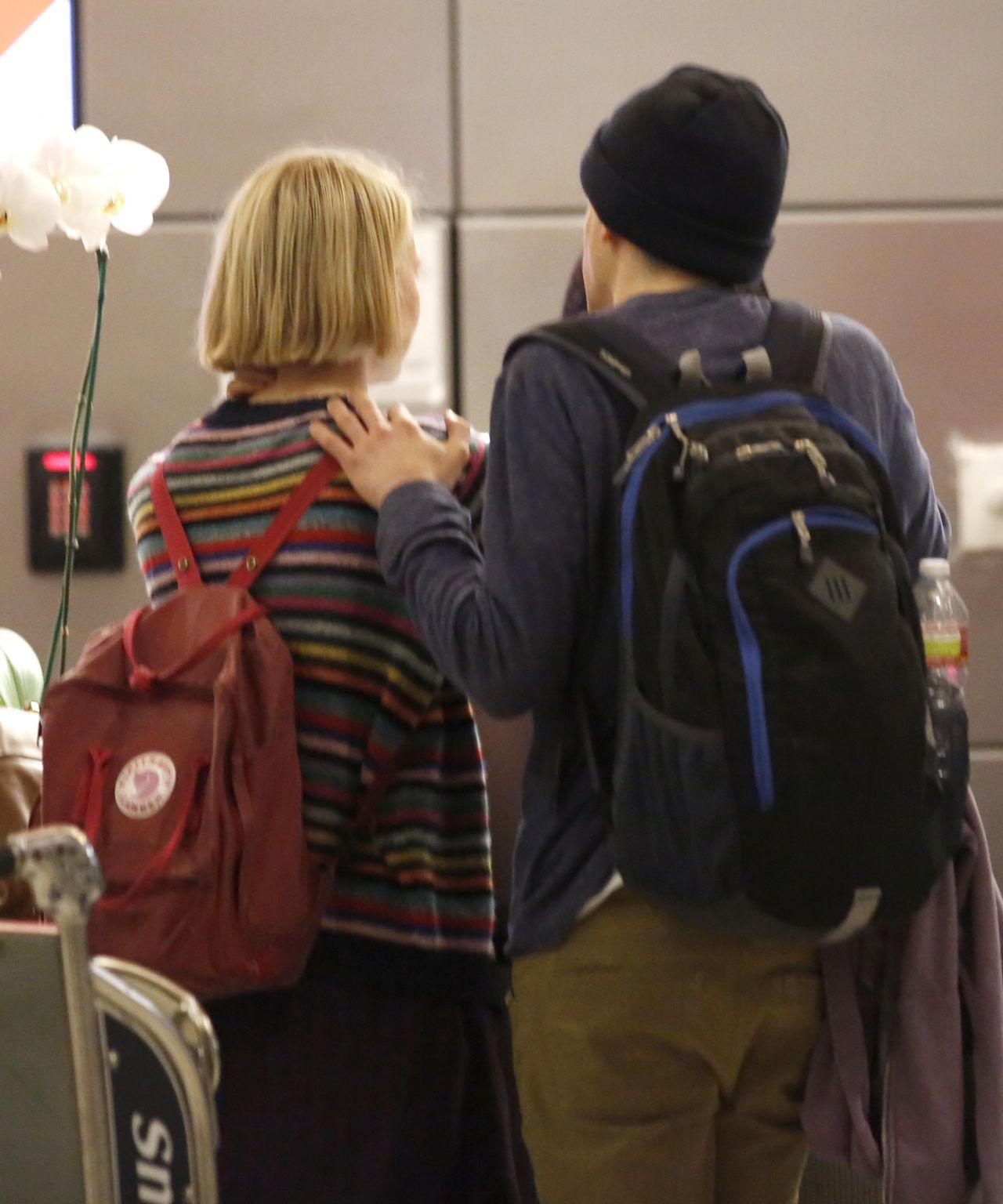 9781b78b39 Mia Wasikowska   Jesse Eisenberg - Share a Kiss at LAX Airport - Nov. 2014