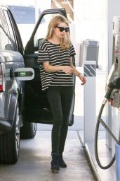 Emma Roberts Filling Up Her Car At A Local Gas Station  - Hollywood, December 2014