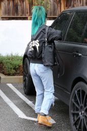 Kylie Jenner in Ripped Jeans - Out in the Rain in Los Angeles, December 2014