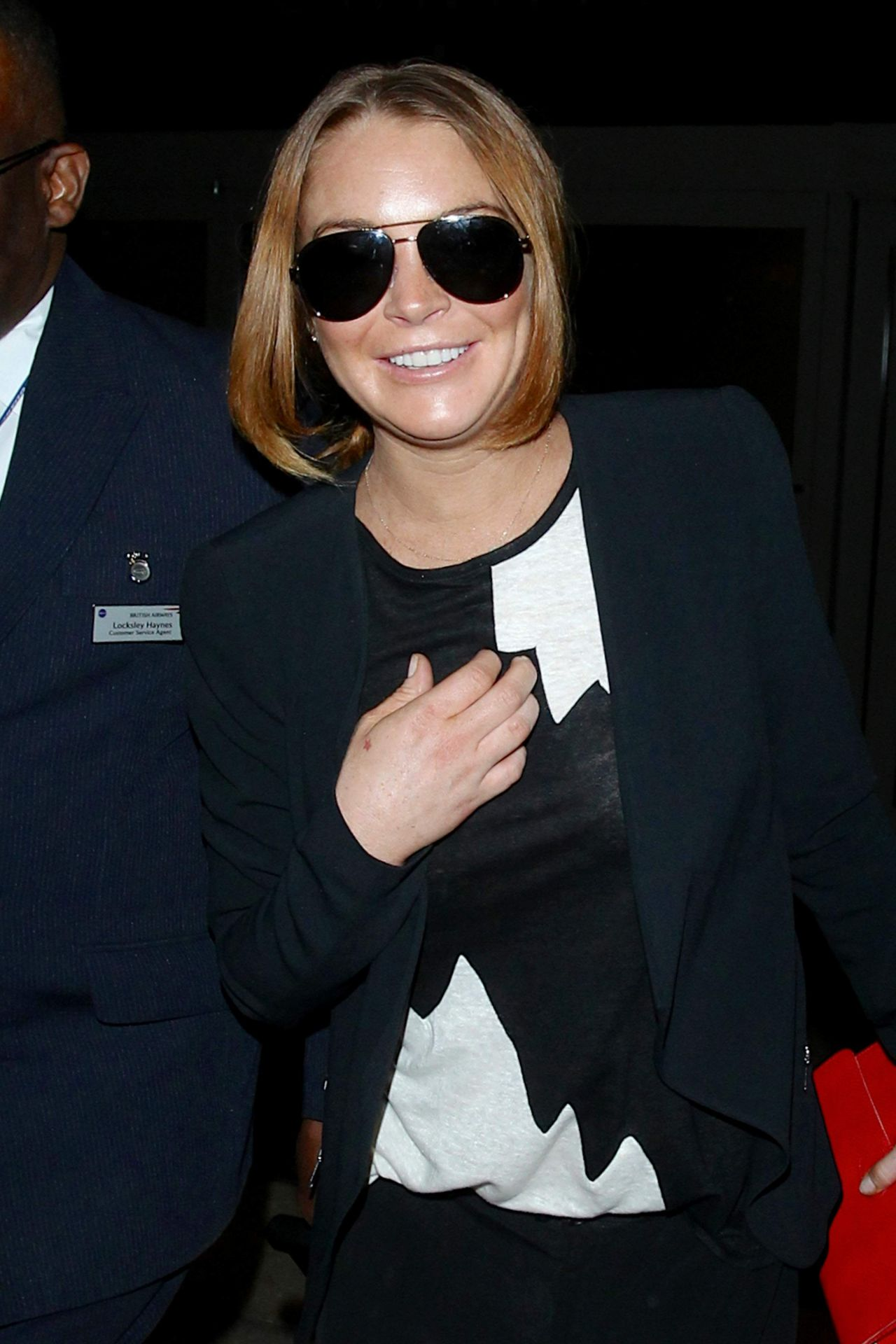 Lindsay Lohan Arriving on a flight at LAX Airport in Los Angeles - December 2014