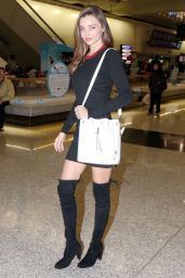 Miranda Kerr in Over Knee Boots at Hong Kong International Airport - December 2014