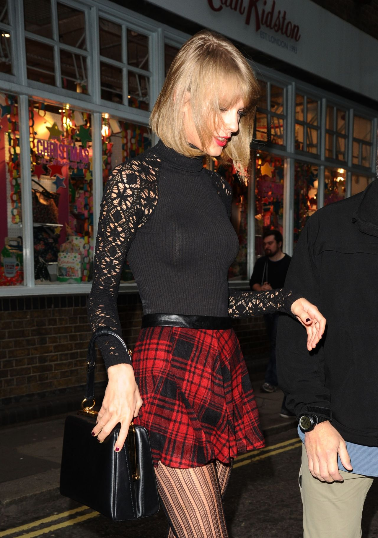 Taylor Swift Displays Long Legs In Mini Skirt Cath