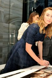 Emily Blunt - Visits the IWC Booth during the SIHH in Geneva