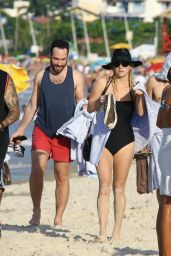 Kesha in a Black Swimsuit at the Beach in Brazil, January 2015