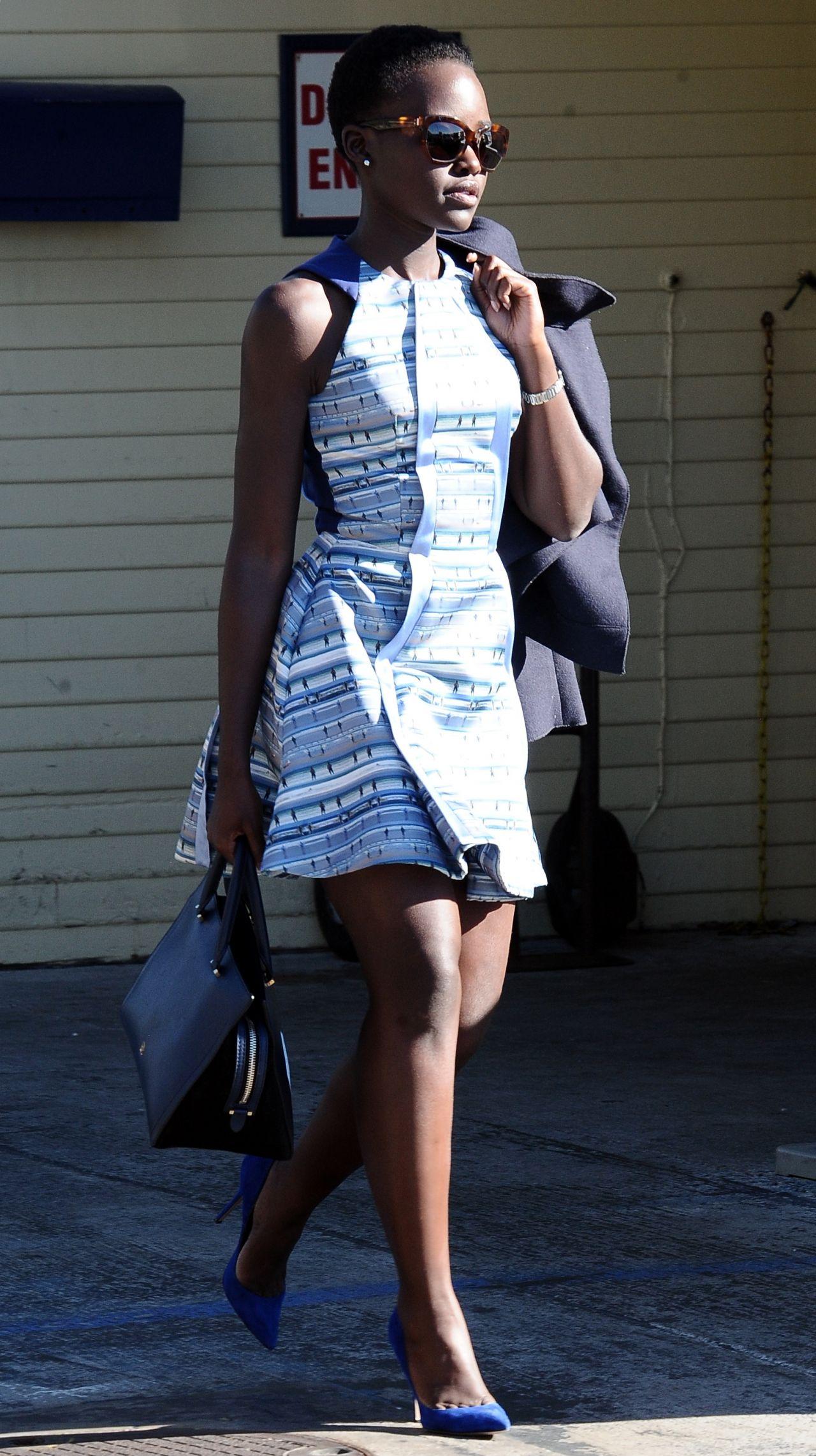 Lupita Nyong'o in Mini Dress - Leaving the Moonshadows ...