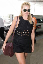Margot Robbie Leggy in Shorts - Sydney Domestic Airport, January 2015