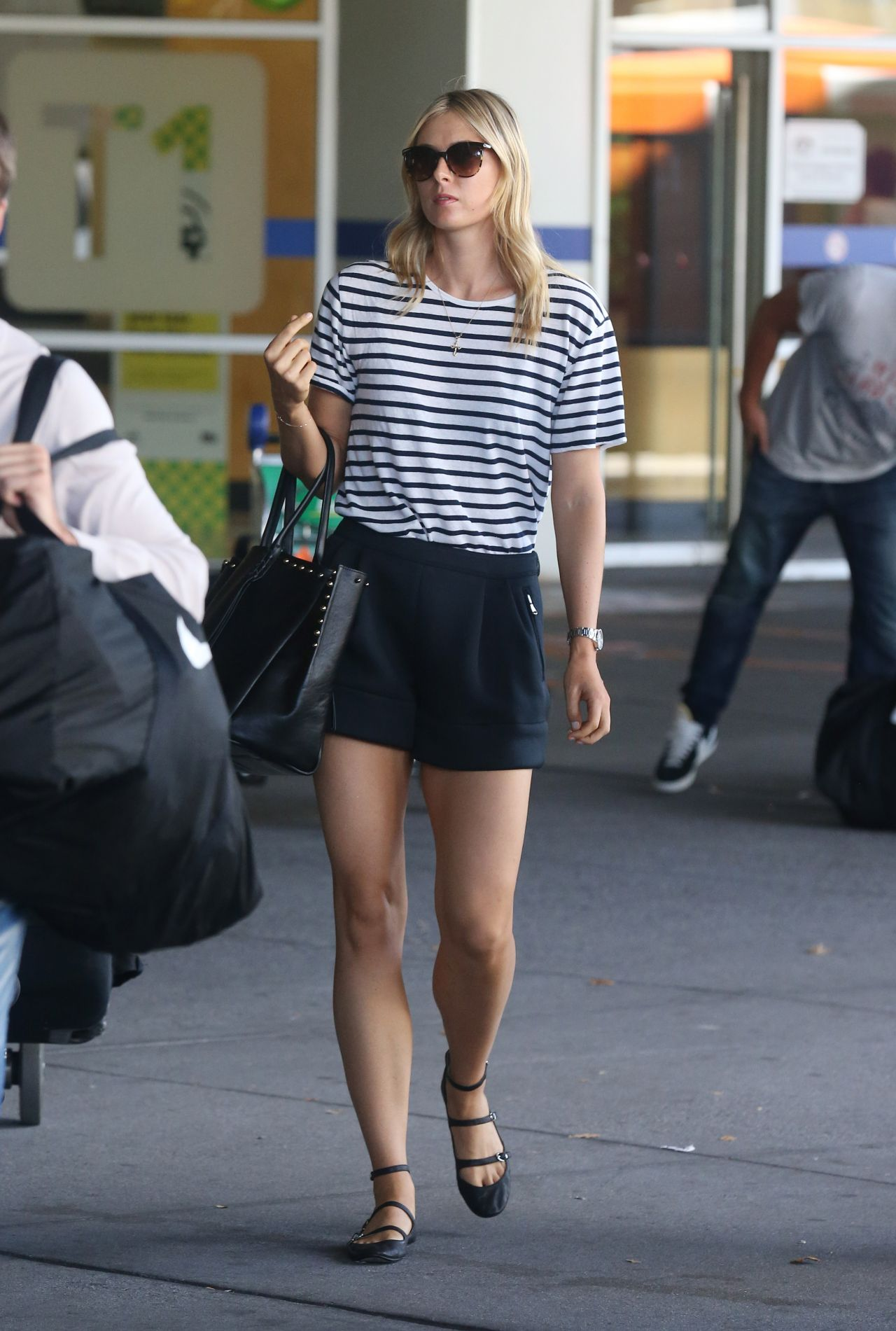 Maria Sharapova Leggy in Mini Skirt - Arrives at Melbourne Airport - January 2015