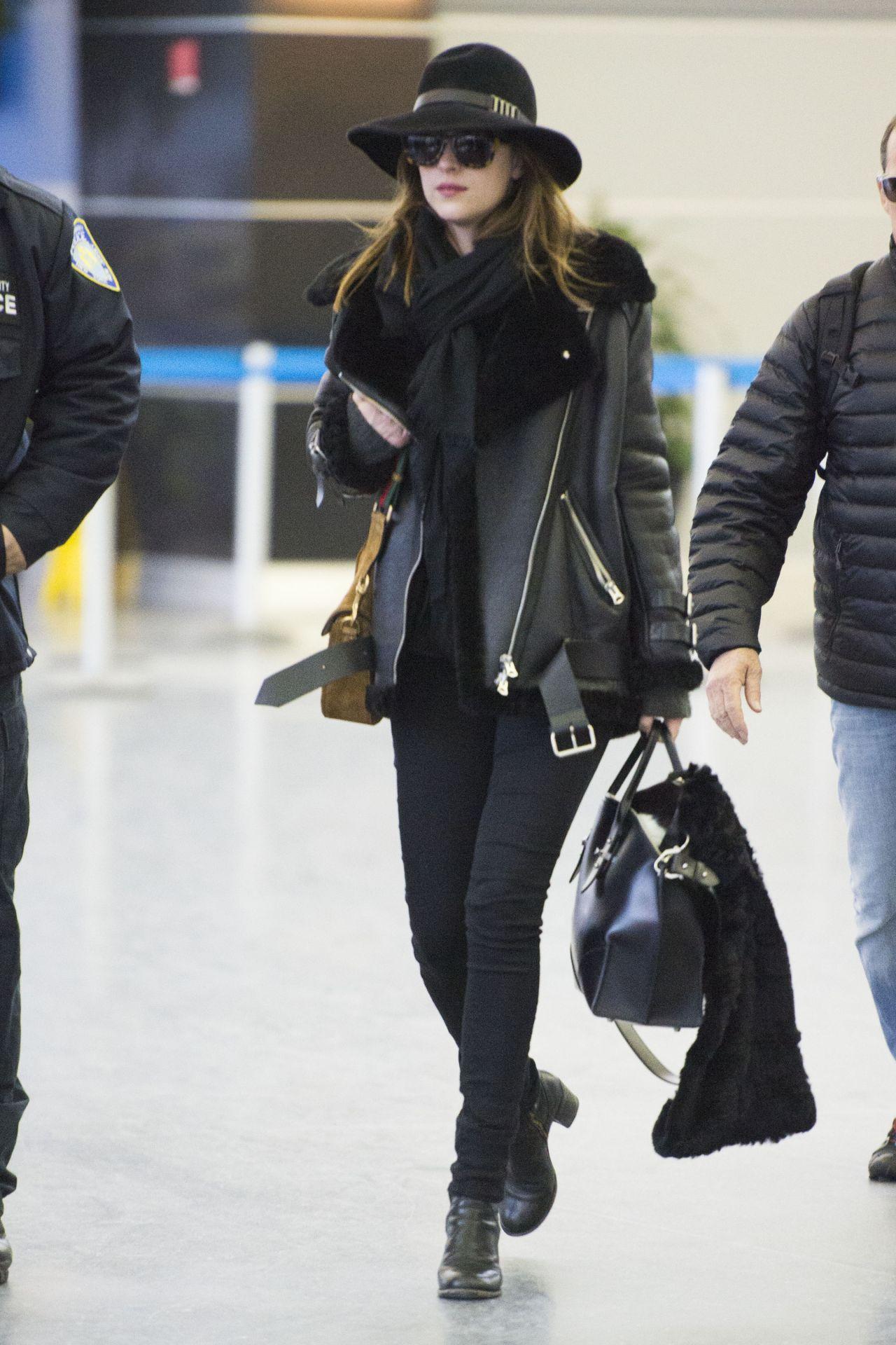 Dakota Johnson Style - at JFK Airport in New York City, Feb. 2015