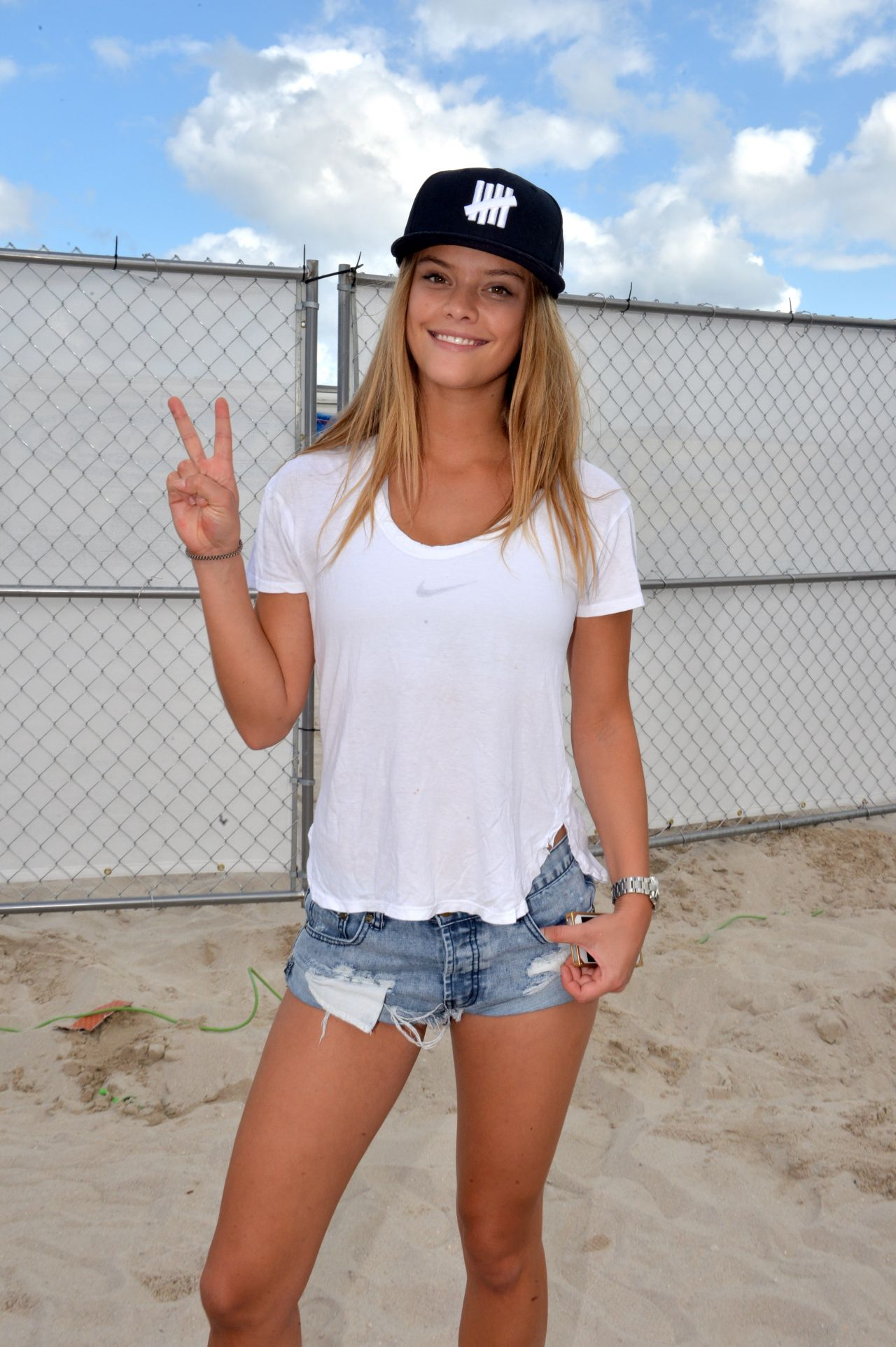 Nina Agdal Leggy in Denim Shorts - in Miami Beach Florida, Febraury 2015